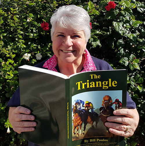 Moree Mayor Councillor Katrina Humphries gets a sneak peak of The Triangle, published with the help of funding from Moree Plains Shire Council.